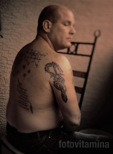 frank calabrese jr showing his tattoos, at his home in phoenix